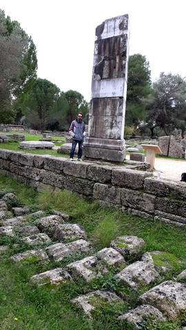 Agrimonti stands next to 5th century pillar of the Nike of Paionios in Olympia