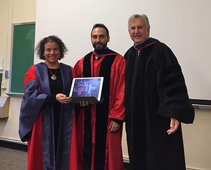 Eleni Hatzaki, Paschalis Zafeiriadis, and Jack Davis pose in regalia after a defense