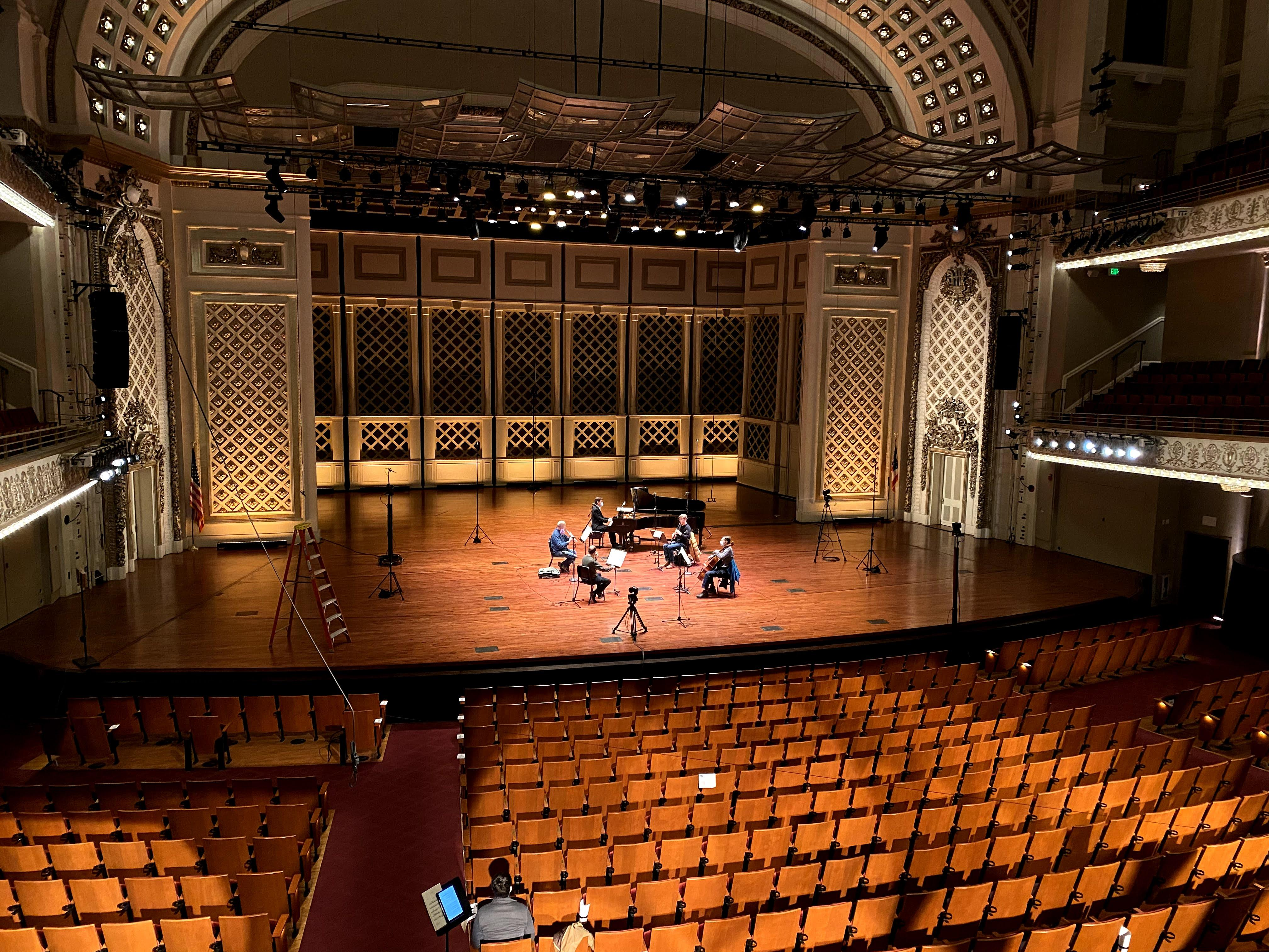Members of the Cincinnati Symphony Orchestra record onstage in an empty hall