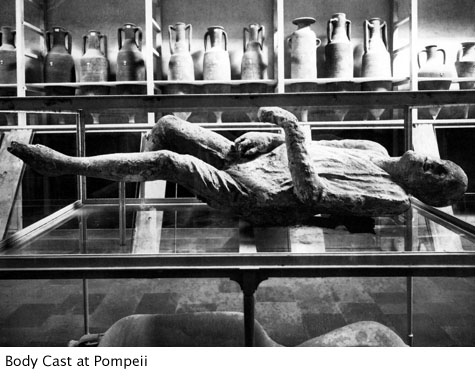 Black and white photo of a body cast from a victim of the Roman Pompeii eruption
