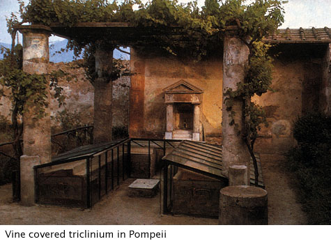 partially restored triclinium with roof and vines at Pompeii